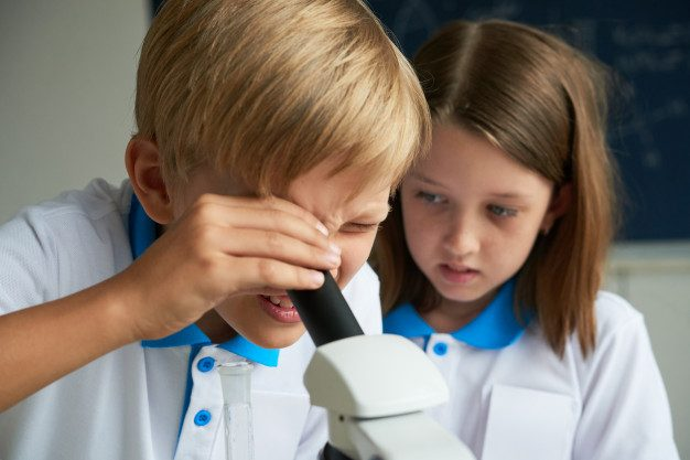 children-learning-chemistry_1098-16774